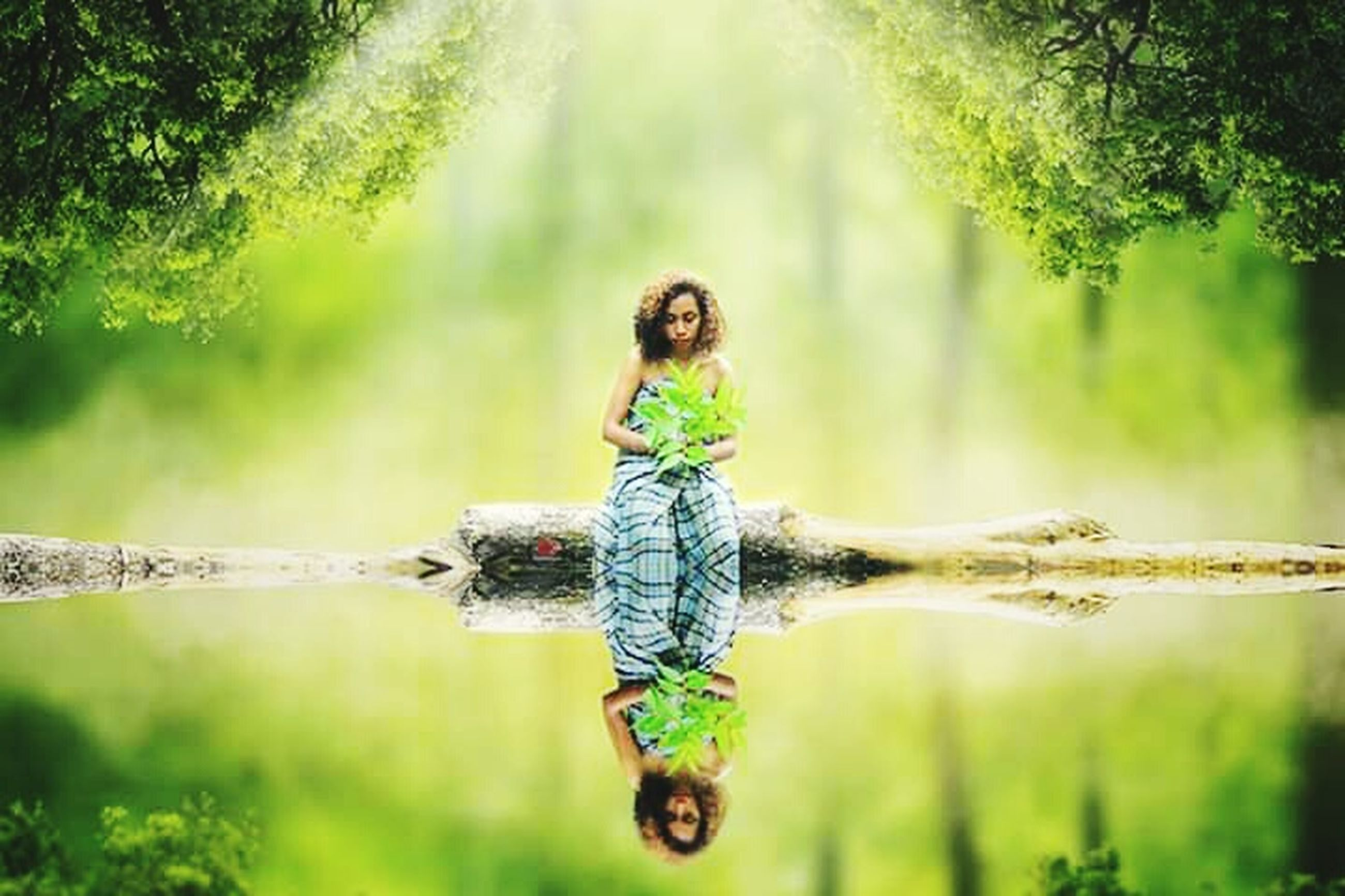 lake, water, one person, plant, tree, nature, reflection, forest, beauty in nature, day, full length, hairstyle, brown hair, selective focus, adult, summer, women, standing water, outdoors