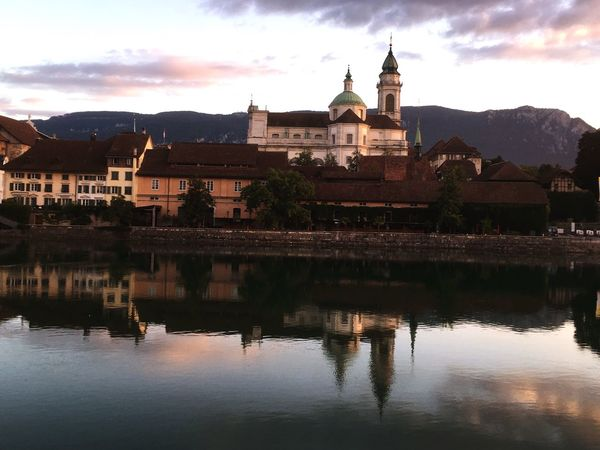 Architecture Building Exterior Built Structure Mountain Sky Water Cloud - Sky Travel Destinations Spirituality Place Of Worship Outdoors No People Religion Day Nature Beauty In Nature Morning Light Morning River Aare Old City Reflection