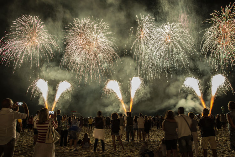 Fireworks. Fireworks Arts Culture And Entertainment Celebration Event Firework Firework - Man Made Object Firework Display Group Of People Illuminated Italy Long Exposure Night Watching The Great Outdoors - 2018 EyeEm Awards The Traveler - 2018 EyeEm Awards