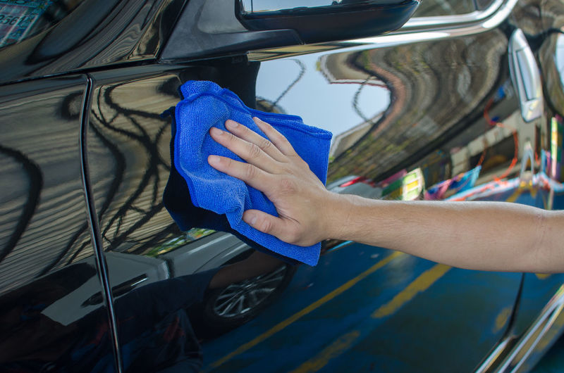 Cropped Hands Of Manual Worker Cleaning Car
