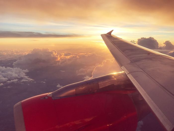 Airplane Transportation Journey Mode Of Transport Airplane Wing Aerial View Cloud - Sky Travel Air Vehicle Aircraft Wing Sky Nature No People Cloudscape Beauty In Nature Mid-air Sunset Scenics Flying Vehicle Part Sunset_collection Sunsets Travel Traveling Travelling