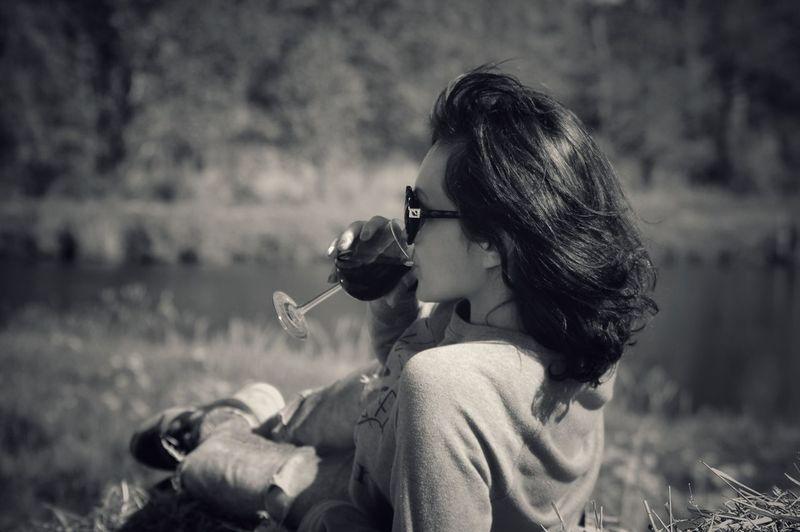 Woman drinking on field