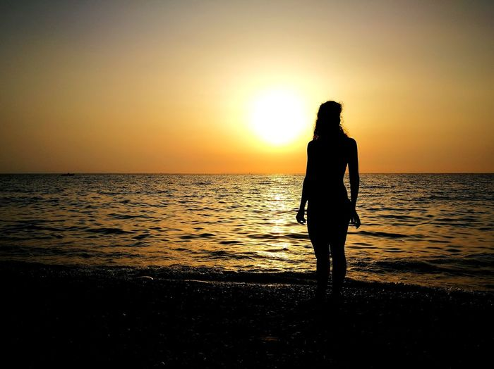 Beach Sea Sunset Silhouette Vacations One Person Horizon Over Water Standing Reflection Sky Scenics Outdoors Summer Only Women Water Nature Young Adult Leica Lens Outdoor Pursuit One Young Woman Only Glamour Girl Travel Destinations Tranquility Black Huaweiphotography Second Acts