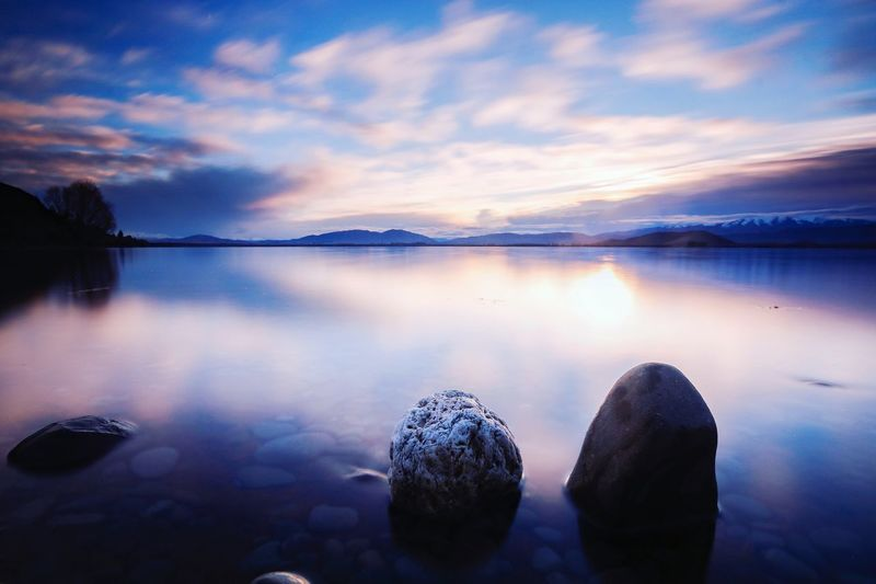 Sunrise over Lake Benmore New Zealand Mountain Rock Silhouette Lakebenmore NZ Nature Photography Sunrise Dawn Water Cloud - Sky Sky Reflection Scenics - Nature Tranquility Tranquil Scene Lake Beauty In Nature Nature Idyllic No People Non-urban Scene Waterfront Outdoors Rock