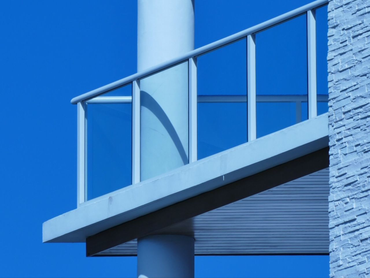 built structure, architecture, blue, low angle view, outdoors, building exterior, metal, day, bridge - man made structure, no people, clear sky, sky, close-up