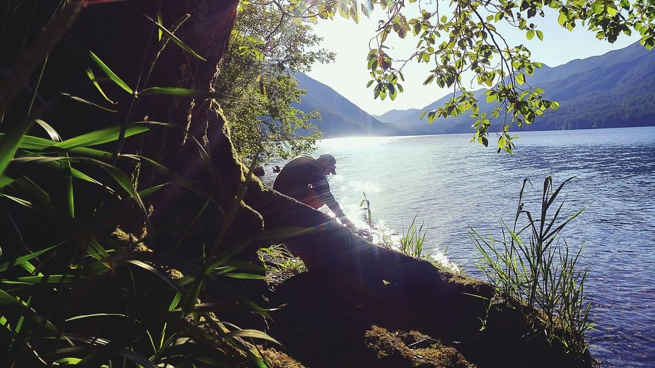 Beautiful Day Peace And Quiet Enjoying The Sun Relaxing Quality Time Sunny Beauty In Nature Lake Nature Man By Lake Blue Color Water_collection Tranquil Scene Tranquility Blue Water On A Hike Meditation Zen Candid Shot Lakeshore Lake Crescent, Washington. Port Angeles One Person One Person On Beach