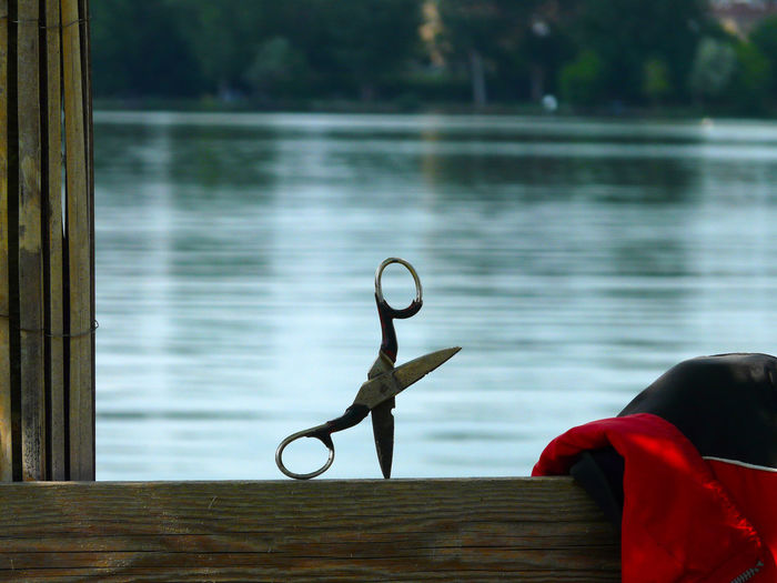 Close-up of toy by lake against window
