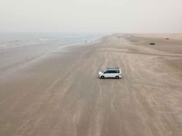 Beach Beauty In Nature Car Climate Day Horizon Horizon Over Water Land Land Vehicle Mode Of Transportation Motion Motor Vehicle Nature No People on the move Road Sand Scenics - Nature Sea Sky Sports Utility Vehicle Transportation Travel