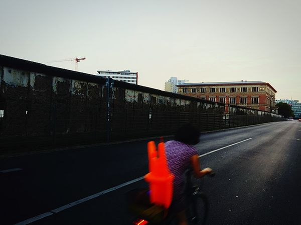 Waytogo Escape Unexpected By Chance All Of A Sudden Red Bicycle Cyclist Architecture Built Structure Building Exterior Road Clear Sky Day Outdoors The Way Forward No People Cycling Cyclist Red