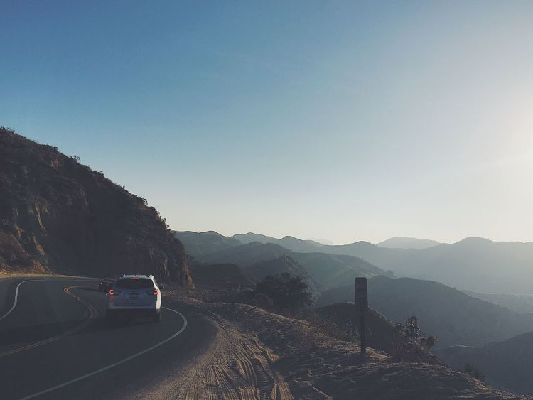 Driving to a place one time Mountain Transportation Road Mountain Range Tranquil Scene Nature Car No People Clear Sky The Way Forward Beauty In Nature Tranquility Scenics Day Landscape Outdoors Sky Driving Roadtrip On The Road Earth Live For The Story VSCO Vscocam Hills