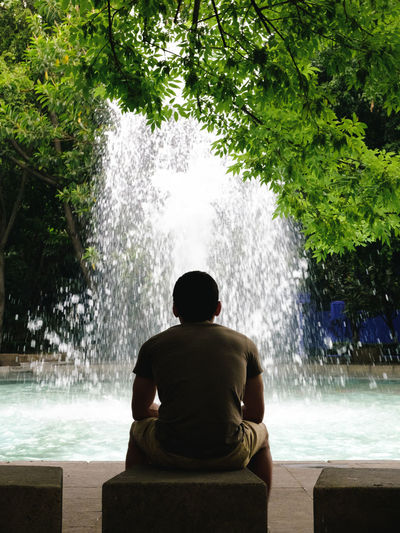 Calm Casual Clothing Contemplating Lifestyles Meditative Outdoors Silhouette Splashing Thinking About Life Tree Water Young Men TCPM