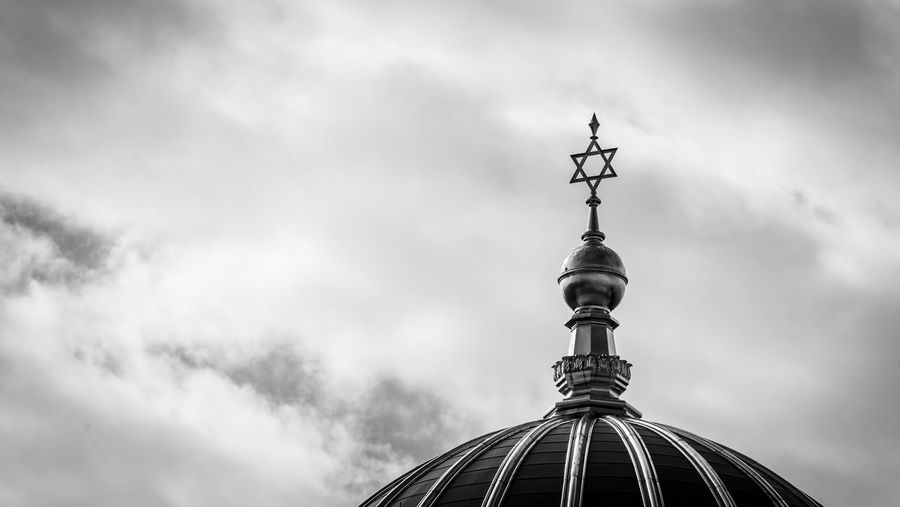 Low angle view of a jewish church against cloudy sky