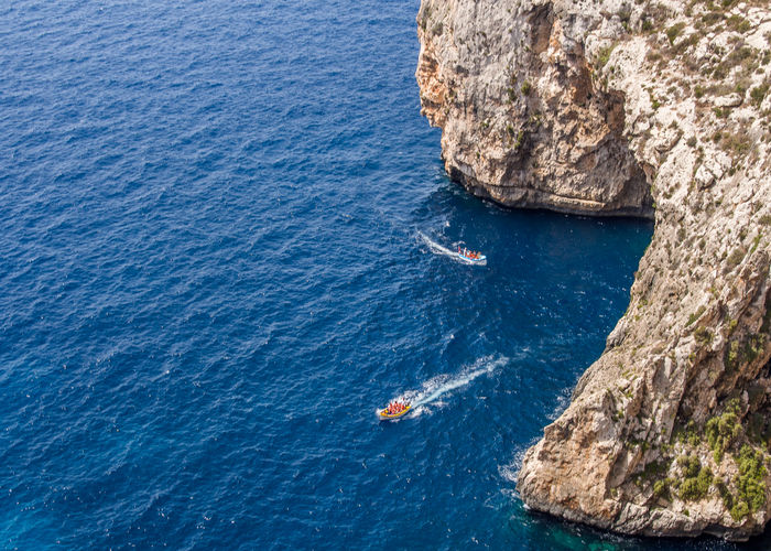 High angle view of rock by sea