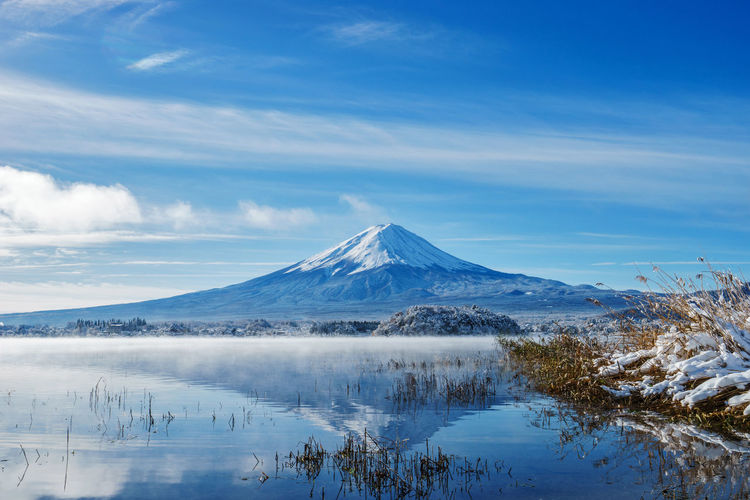 The breathtaking view of Mt. Fuji in autumn at Kawaguchiko lake, Japan. Mt. Fuji is commonly called as Fuji-san, Fujisan, Fuji mountain. Fuji mountain is one of the well known symbol of Japan. Beauty In Nature Blue Cold Temperature Day Fujian Glacier Japan Kawaguchi Lake Landscape Mountain Nature No People Outdoors Scenics Sky Snow Water