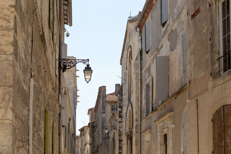 Building exterior at the old town, Arles Architecture Building Exterior Built Structure City City Life Culture High Section History Lantern Low Angle View Narrow No People Old Town Outdoors Residential Building Residential Structure Sky Street Light Tourism Town Travel Destinations Window