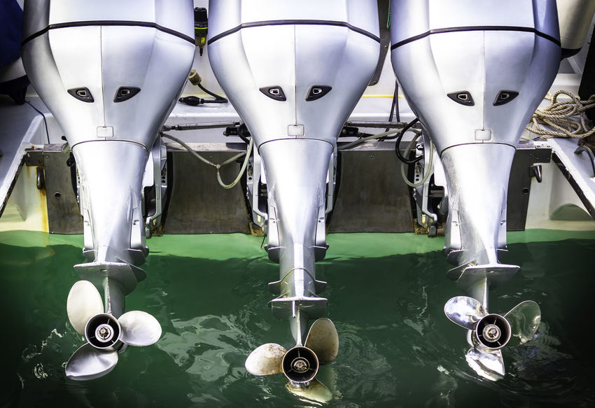Three speed boat engine with propeller background Business Extreme Harbor Industry Machine Motor Rotor Boat Cruise Engine Marine Metal Motorboat Motorized Nautical Powerboat Propeller Sea Ship Speedboat Sport Technology Vehicle Water Yacht