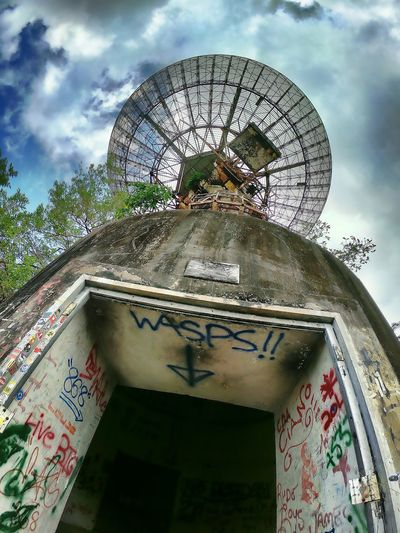 Chaguaramas tracking station ,Trinidad and Tobago Antenna Antenna - Aerial Travel Destinations Tranquil Scene HDR Chaguaramas Cloud Graffiti Graffiti Art Abandoned Places Architectural Column Trinidad And Tobago Outdoors Tree Sky Architecture Close-up Built Structure Building Exterior Cloud - Sky
