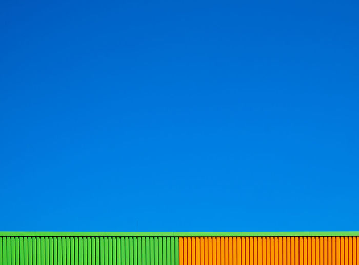 Orangething Fujix_berlin Ralfpollack_fotografie Minimalism Minimalist Photography  Architecture Built Structure Wall - Building Feature Pattern Backgrounds Orange Color Blue Copy Space No People Green Color Sky Day Clear Sky Multi Colored Outdoors Blue Background Corrugated Industry
