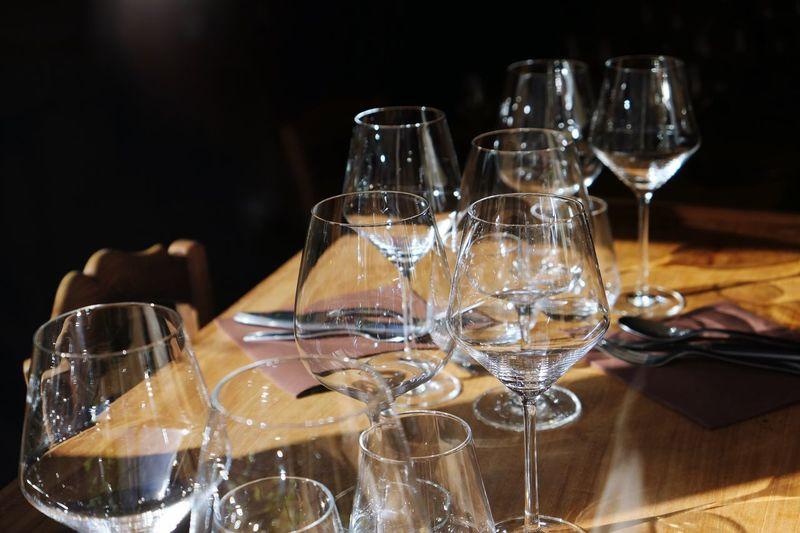 Wineglasses arranged on table at restaurant