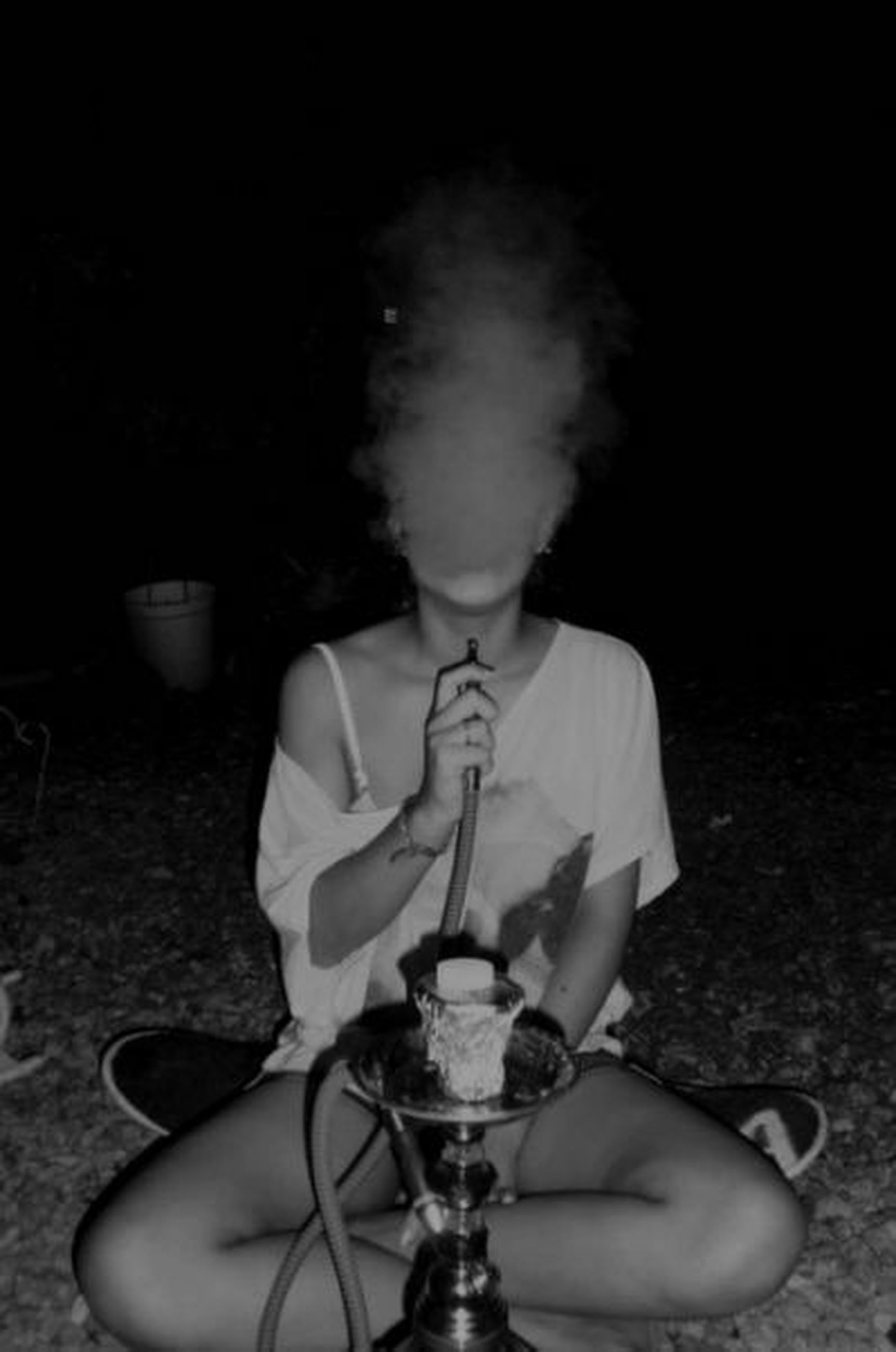 one person, one woman only, adults only, only women, holding, people, adult, smoke - physical structure, indoors, day