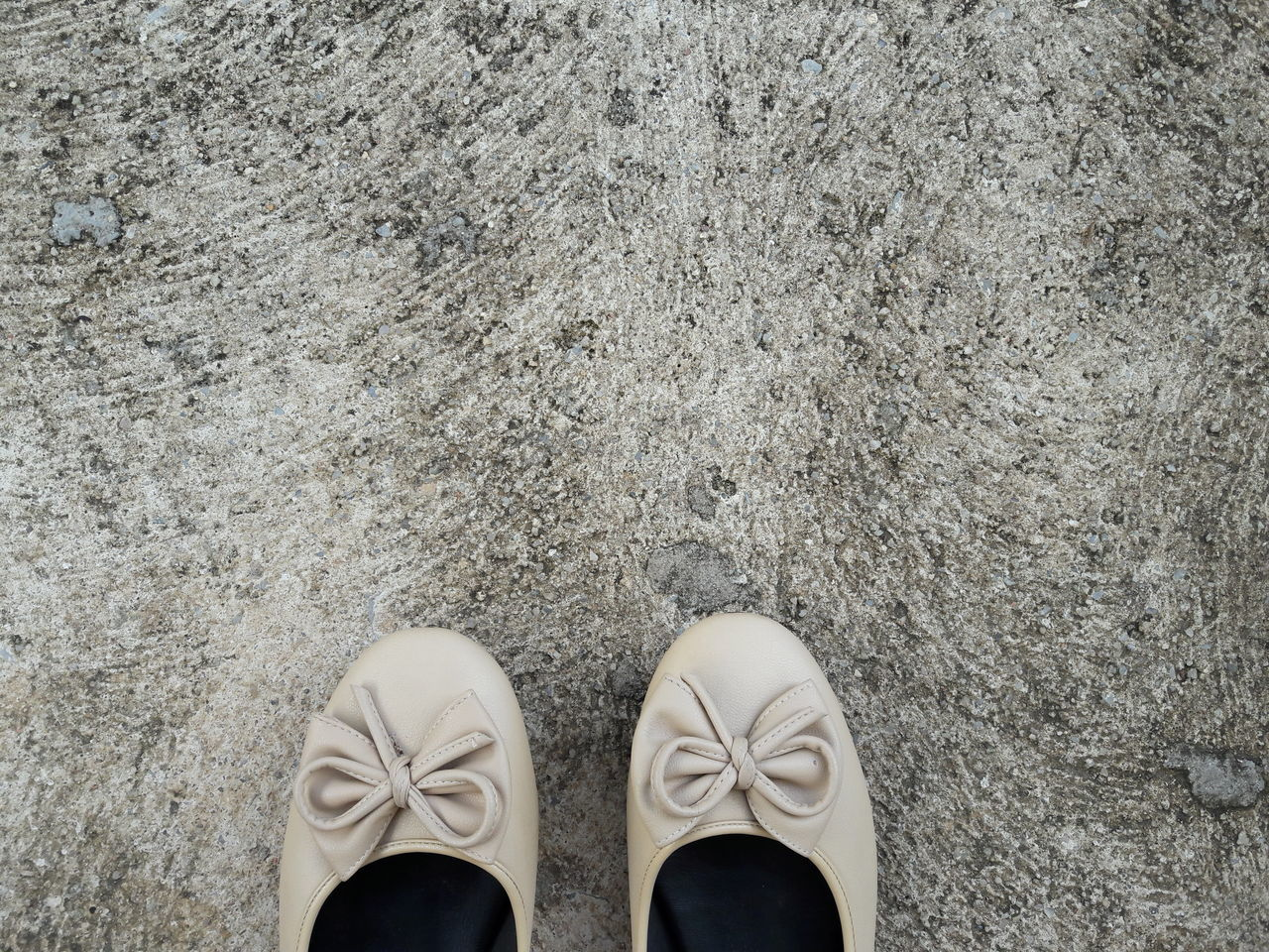 High Angle View Of Sandals On Concrete Floor