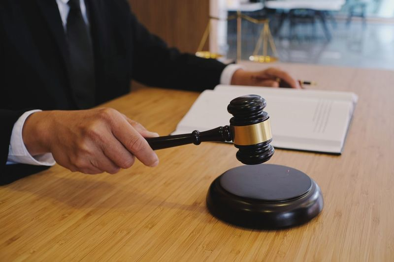 Justicefortreyvon Authority Lawyer Scale  Advice Close-up Consultation Consulting Document Gavel Human Hand Indoors  Information Sign Judgment Landscape Legal Litigation Notary One Person Process Punishment Jail Gavel Mallet Punishment Flow  Real People Symbol Table
