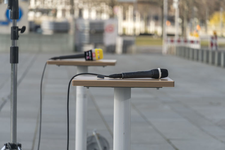 Microphone on table outdoors. focus on foreground