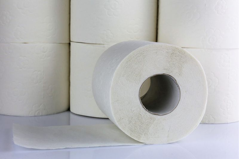 Close-Up Of Rolled Toilet Papers On Table