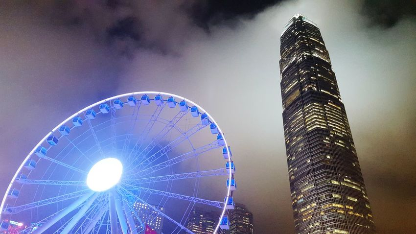 Ferris wheel and IFC. Central Hong Kong IFC Ferris Wheel Neon Lights The Architect - 2016 EyeEm Awards Clouds Work And Fun Architecture Urban Exploration