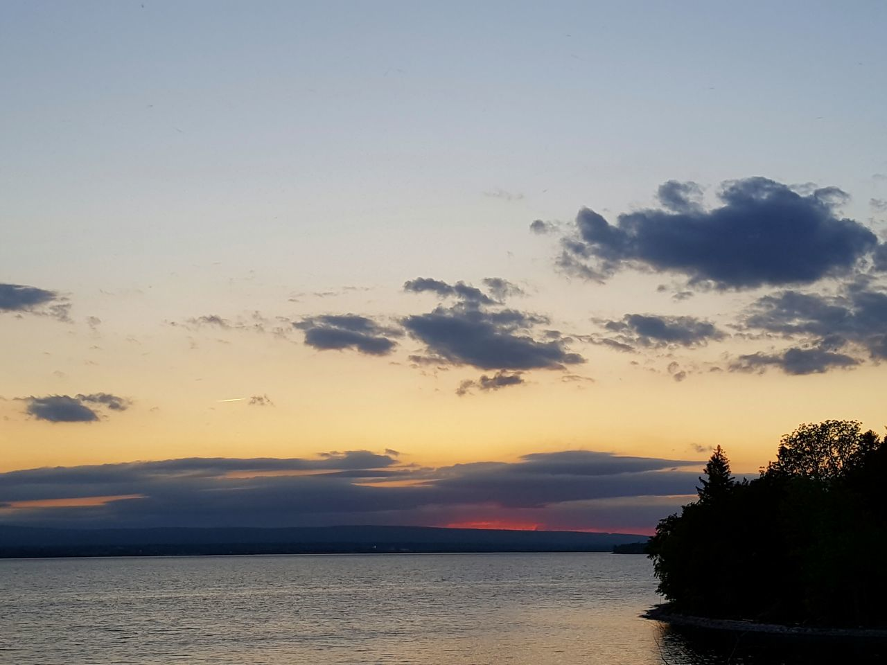 sunset, sky, scenics, tranquil scene, tranquility, beauty in nature, water, silhouette, no people, sea, nature, cloud - sky, tree, horizon over water, outdoors, day