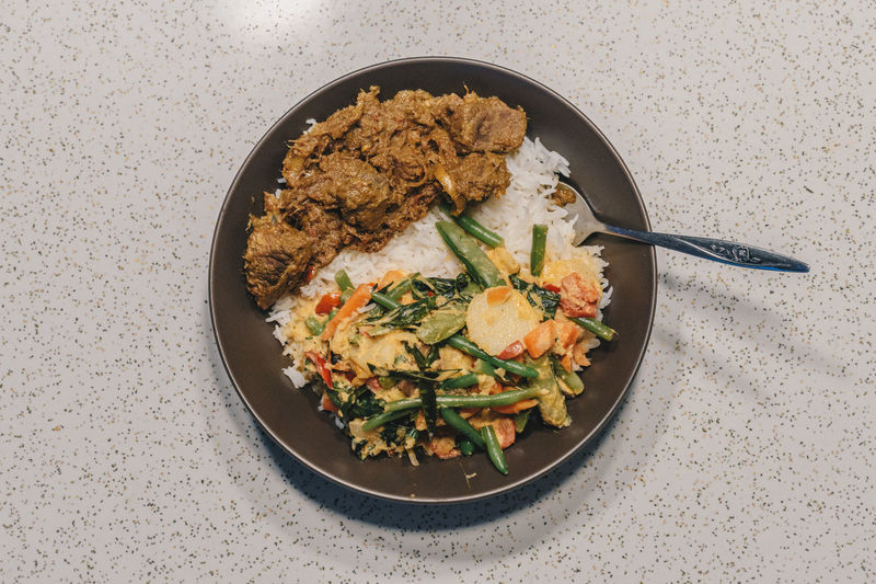 indonesian rendang with vegetables Curry Directly Above Food Food And Drink Fork Freshness Garnish Indoors  Meal No People Plate Ready-to-eat Rendang Studio Shot Table Vegetable