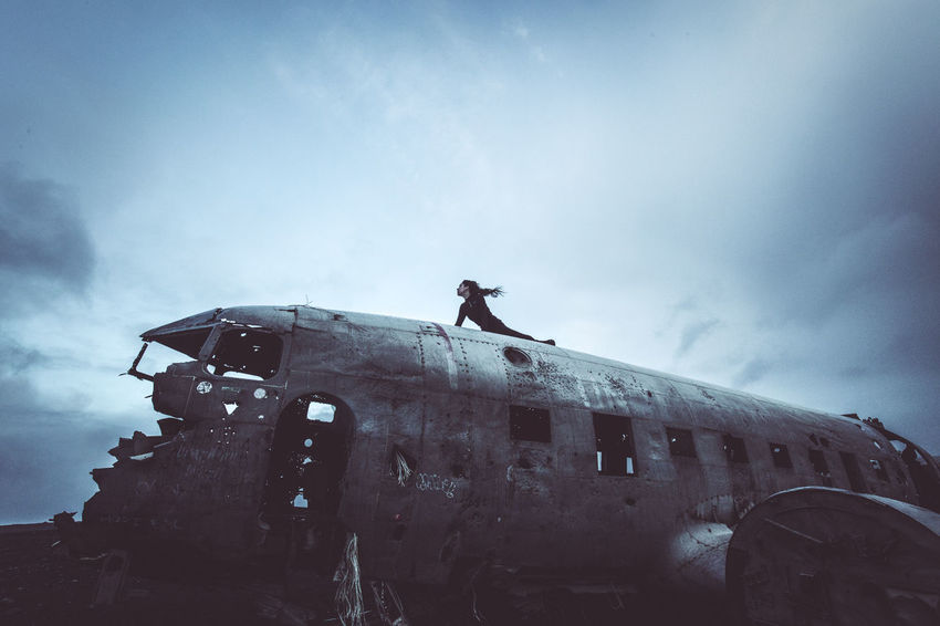 Days of travel: 6 - Sólheimasandur Plane Wreck Abandoned Places Iceland Planetary Moon Abandoned Air Vehicle Airplane Bad Condition Cloud - Sky Damaged Day Deterioration Leisure Activity Low Angle View Men Mode Of Transportation Nature Obsolete One Person Outdoors Real People Ruined Run-down Shipwreck Sky Transportation The Great Outdoors - 2018 EyeEm Awards The Traveler - 2018 EyeEm Awards