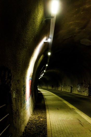 Nordbahntrasse EyeEm Gallery EyeEm Selects EyeEm Best Shots Illuminated Night Transportation The Way Forward No People Lighting Equipment Tunnel Street Wet Architecture Diminishing Perspective Direction Road Glowing Light City Electric Light Reflection Outdoors Nature