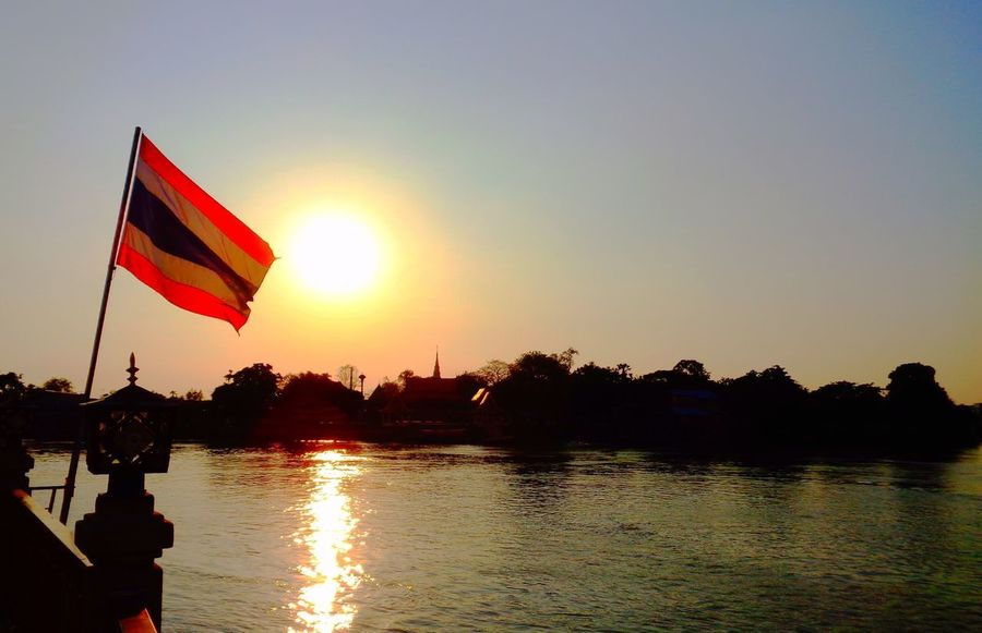 Sunset Chao Phaya River Flag Sunset Water Silhouette Reflection Nature Outdoors Tranquility Beauty In Nature Sky Sun No People Scenics Clear Sky Day