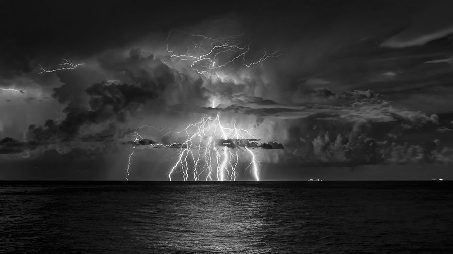 Lightning Over Sea At Night