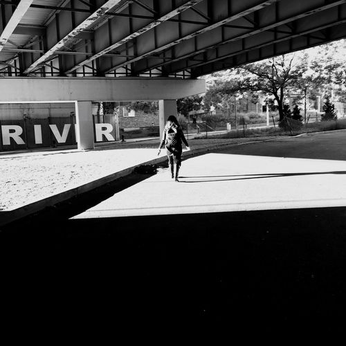 Full Length One Person Real People Lifestyles Walking Leisure Activity Architecture Built Structure Outdoors Day Shadow Childhood Building Exterior Tree People Adult EyeEm Best Shots - Black + White Eyeem Market Shadows & Lights EyeEm Bnw EyeEm Selects Shadow And Light Eyeem Photography Silhouette EyeEm Gallery