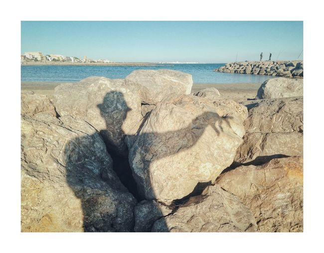 Catch me if you can Sea Beach Horizon Over Water Shadow Selfportrait Art Is Everywhere EyeEm Best Shots Eyem Nature Lovers  Water Nature Sand Shore Rock - Object Rock Outdoors Day Scenics Tranquility Clear Sky Tranquil Scene Beauty In Nature Vacations No People Sky