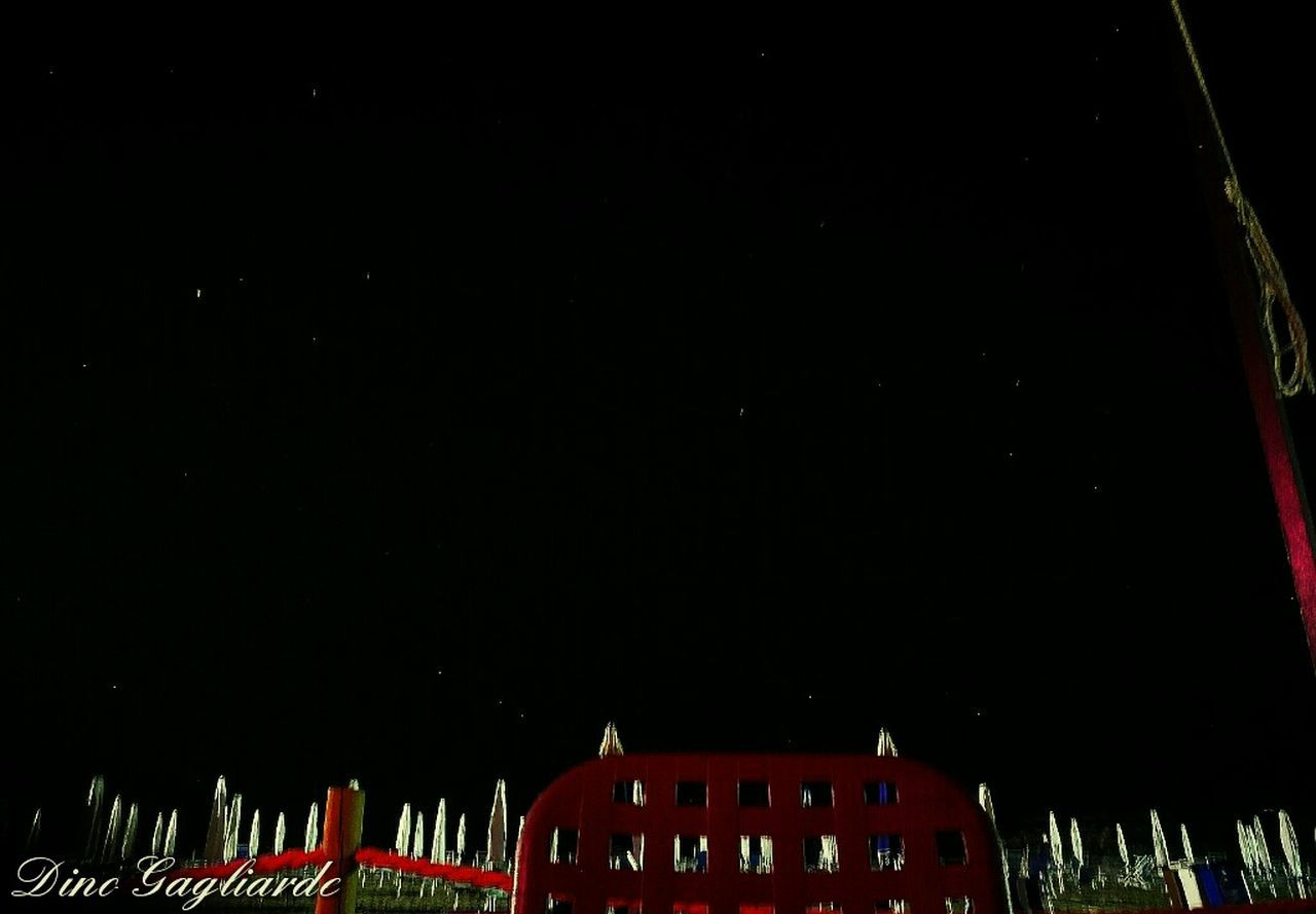 night, copy space, built structure, architecture, red, building exterior, low angle view, no people, outdoors, illuminated, nature, sky