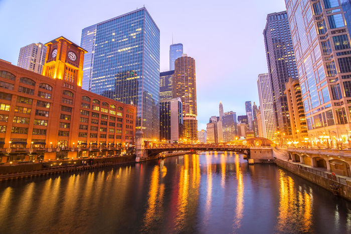 View of skyscrapers in downtown Chicago on either side of the Chicago River Architecture Building Building Exterior Buildings Built Structure Chicago Chicago Architecture City Cityscape Colorful Destination Downtown Downtown Chicago Frozen Hancock HancockTower Horizon Illinois Lake Landmark Modern Office Building Outdoors Panoramic Winter