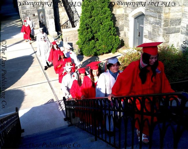 St. Bernard HS graduates march to the cathedral for commencement.
