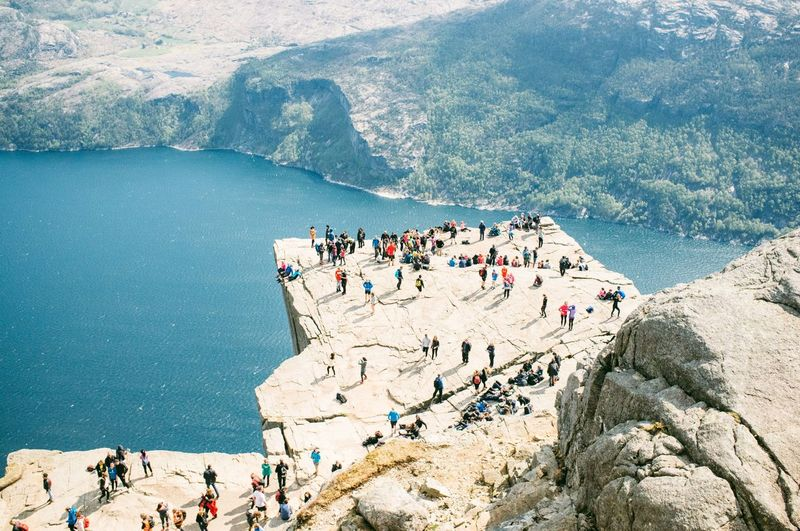 Tourists on rocks at beach