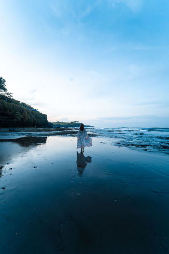 Water One Person Real People Sky Beauty In Nature Lifestyles Scenics - Nature Full Length Leisure Activity Nature Sea Tranquility Beach Land Standing Day Side View Tranquil Scene