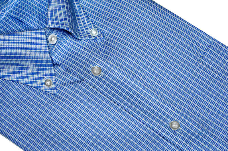 Close-Up View Of Blue Shirt On Table