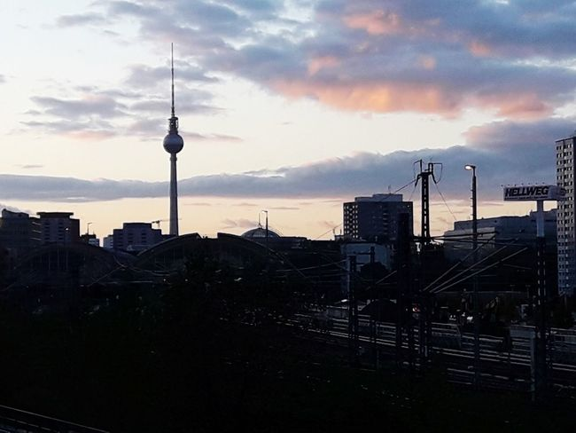 Telespargel Fernsehturm Berlin  Fernsehturm Alexanderplatz In Berlin Germany Urban Tower Architecture Tall - High Travel Destinations Communication Built Structure Sunset Building Exterior City No People Cloud - Sky Silhouette Sky Urban Skyline Modern Orange Color Dramatic Sky Atmospheric Mood Idyllic Evening Television Tower - Berlin Television Tower Communications Tower Moody Sky The Traveler - 2018 EyeEm Awards