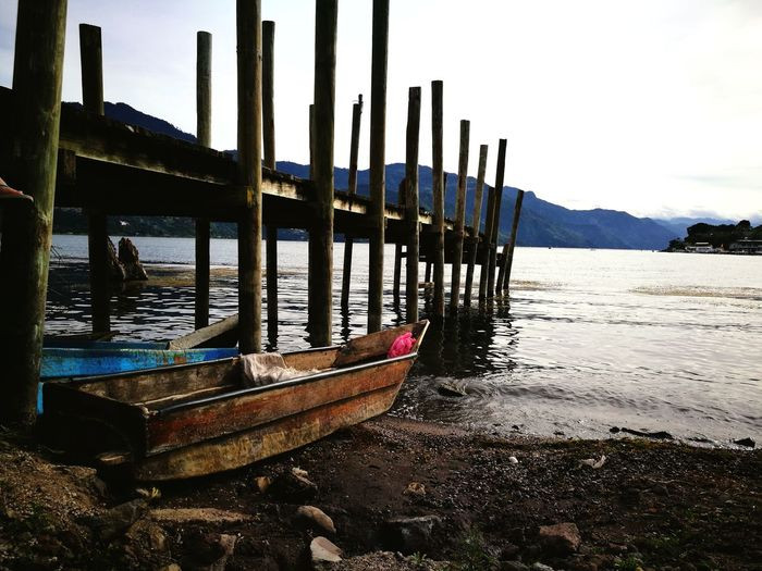 Water Nautical Vessel Beach Wood - Material Moored Sand Tranquility Sea Outdoors Transportation Landscape Wooden Post No People Sky Day Nature Architecture
