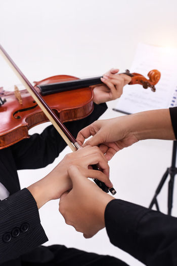 Artist Arts Culture And Entertainment Bow - Musical Equipment Finger Hand Holding Human Body Part Human Hand Music Musical Equipment Musical Instrument Musician People Performance Playing Real People Skill  String String Instrument Violin Violinist Women