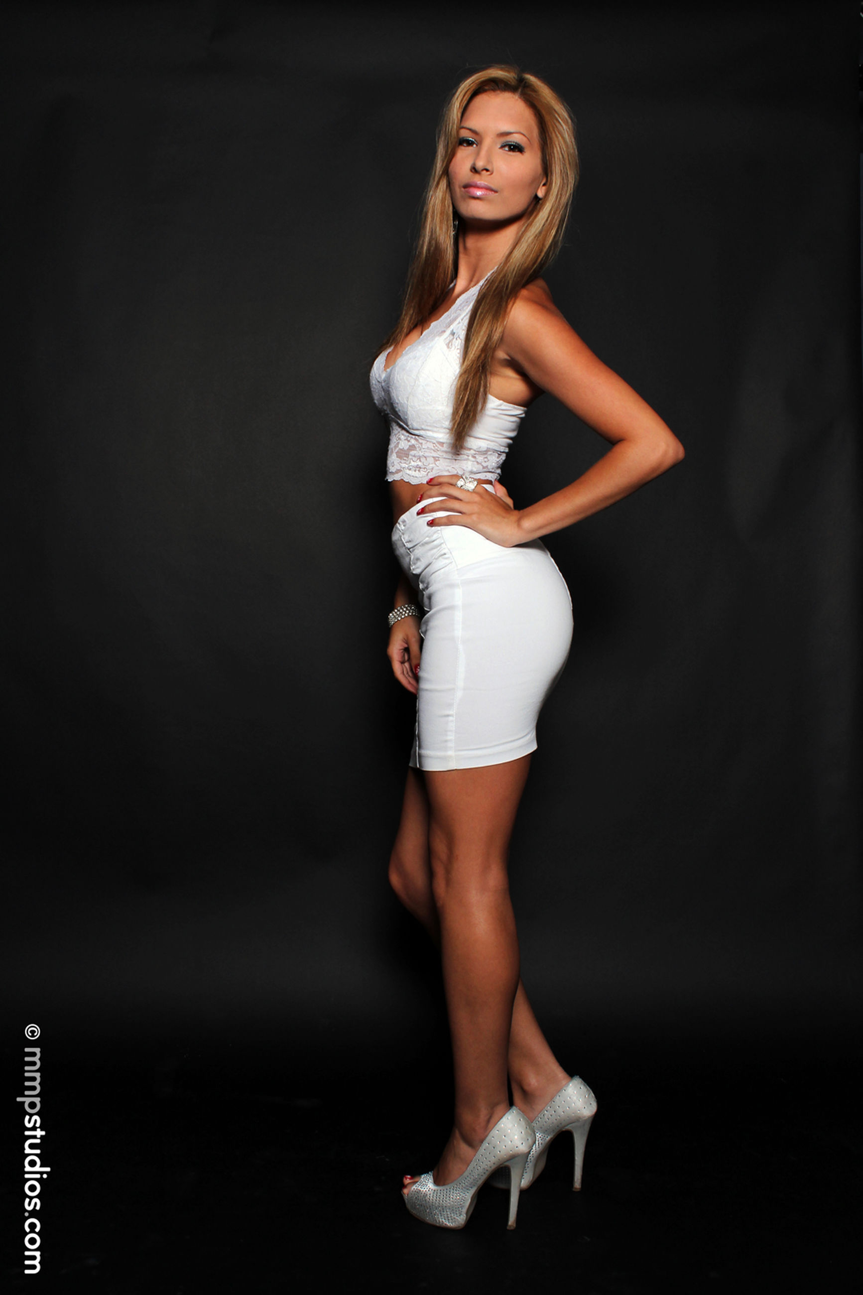 one person, beauty, young women, beautiful woman, young adult, standing, women, portrait, indoors, looking at camera, fashion, full length, hair, blond hair, clothing, black background, studio shot, adult, hairstyle
