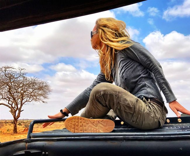 One Person Sitting Blond Hair Sky One Woman Only Bare Tree Tree Outdoors Safari Kenya Savannah Tsavo Est Safari Adventure Safari Park Jeep