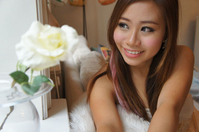 Smiling young woman at home