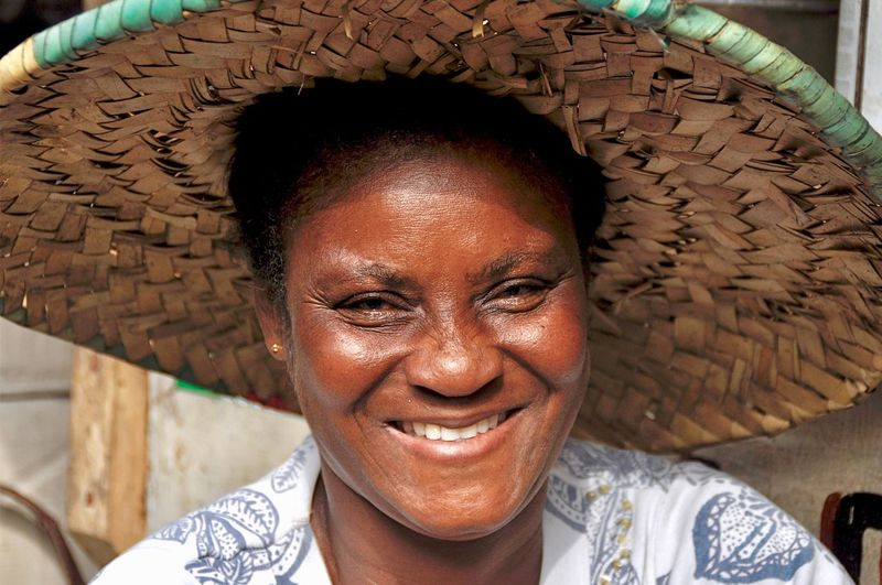 Portrait of smiling mature woman wearing straw hat